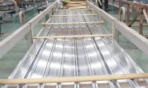 铝型材压双牵引关键技术的探讨