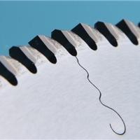 铝合金锯片粘齿是什么原因