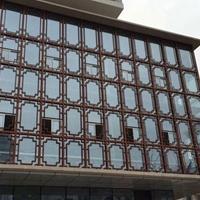江西吉安市街道改造仿古木纹铝窗花厂家