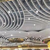 影院幕墙装饰弧形铝方通_木纹弧形铝方通