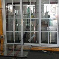 钛镁铝合金钢化玻璃推拉门三轨定做