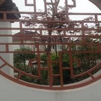 漳州复古铝窗花幕墙 刨花木纹铝窗花厂家