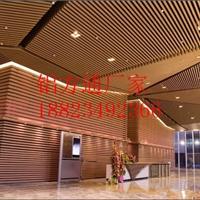 旅馆木纹弧形铝方通吊顶艺术装饰