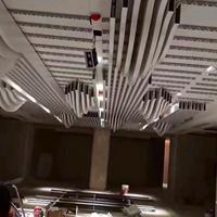 梧州东高铁站候车公共区造型木纹铝方通
