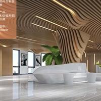 商场工程装饰木纹弧形铝合金天花吊顶