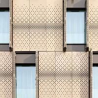 特色酒店外墙穿孔铝单板定制厂家