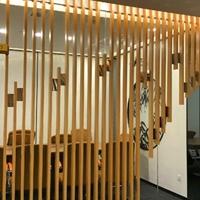 游客接待中心木纹弧形铝方通logo墙